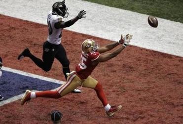 49ers coach Jim Harbaugh said Michael Crabtree was held on this key end zone pass.